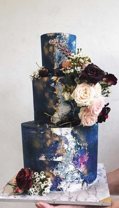 I love all of the colors on this cake, i would take the flowers off