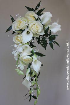 Wedding Bouquet - Bride's Crescent Shower Bouquet. Featuring white calla lillies, orchids and roses. www.uniqueweddingflowers.co.uk