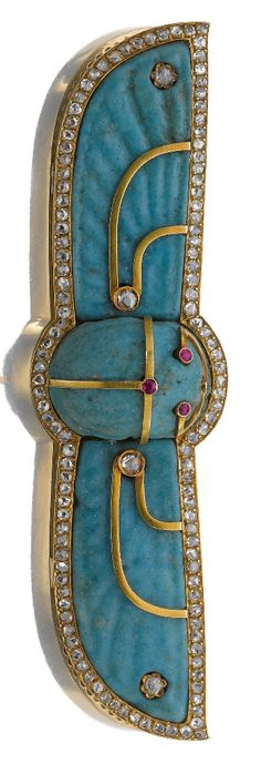 Faience and diamond brooch, late 19th century. In the Egyptian Revival style, designed as a winged scarab in blue faience, accented with rose diamonds and circular-cut rubies. #EgyptianRevival #scarab #brooch