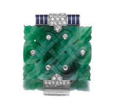 JADEITE, ENAMEL AND DIAMOND CLIP, CARTIER, PARIS, 1930S