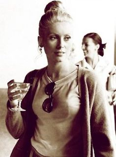 Catherine Deneuve. Love everything about this photo. Effortlessly fly. Look how the shades are just hanging off her tee. The drink. Very nonchalant...