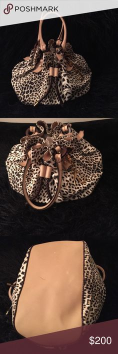 Roberto Cavalli leopard bucket bag Authentic Roberto Cavalli medium sized bag. Leopard print fabric. Leather trimming. Leather drawstring closure. Silk lining on the interior of bag. In excellent pre-loved condition. Minor scratching on bottom but not visible when carried. It is a beautiful lightweight bag. Retails for $650. Offers accepted through OFFER BUTTON ONLY 👇🏾. Roberto Cavalli Bags