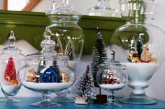 I love this seasonal decor idea for oversized apothecary jars. In addition to Christmas scenes, you could stuff them with colorful fake leaves in the fall, Easter eggs in the spring, or wash them out and fill them with candy Christmas Tree With Snow, Christmas Jars, Christmas Scenes, Christmas Villages, All Things Christmas, Winter Christmas, Christmas Home, Vintage Christmas, Winter Snow