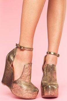 Jeffrey Campbell  Thelma Platform Wedge  $185.00    Amazing distressed bronze platform wedges featuring cutout sides and buckled ankle strap closure. Genuine leather lining. Perfect paired with a chiffon blouse and cropped skinnies! By Jeffrey Campbell.