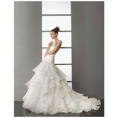 Ball gown floor-length organza bridal gown with appliques... ($399)