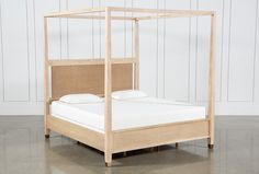 Rooted in 1940s French design, the Gramercy canopy bed by Nate and Jeremiah is at once sophisticated and natural. The bed is brimming with fresh details, like sleek molding, architectural lines and champagne hardware. A washed khaki finish highlights the sturdy hardwood and oak veneer construction, while Danish paper cord paneling shows Gramercy's soft side.