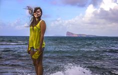 Breezy day at the beach. - My stunning friend posing in front of the famous Gunners Quoin (Coin de Mire), Mauritius on a partly cloudy and quite windy  summer day.