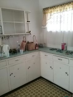 Kitchen with old brittle fomica tops and air vent cupboards