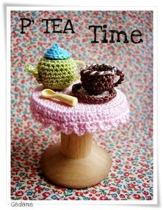 Amigurumi table, tablecloth, teapot and a cup