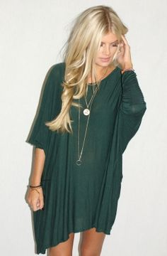'oversized' slink dress / long, layered necklaces.