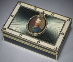 Presented on behalf of Nicholas II to Gabriel Hanotaux by the former Grand Duke Nicholas of Russia, 1917;  acquired by Queen Mary and given to King George V on his birthday 3 June 1934              Gem-set presentation boxes set with a miniature portrait of the Tsar.  This box was one of the last imperial presentation boxes ever to have been given on behalf of the Tsar.