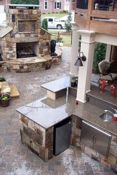 Hardscape with Fireplace and Outdoor Kitchen.