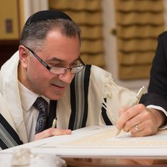 Rabbi Lev Herrnson, endorsing a ketubah at the signing ceremony, just before the actual wedding.