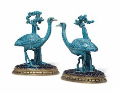 A pair of ormolu-mounted Chinese export turquoise porcelain ostriches   the porcelain 18th century, the mounts circa 1820-1830   each modeled as an ostrich beside trees on a rocky mound