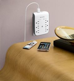 Alternative to extra phone chargers: a surge protector with built-in USB ports. Now, there's a handy item! (You can even buy wall outlets with built-in USB ports. Check out this post from NYT's Personal Tech section : http://gadgetwise.blogs.nytimes.com/2012/01/30/a-power-outlet-with-usb-ports-built-in/.)