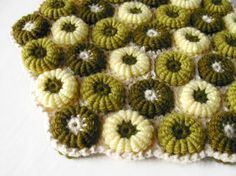 Green floor cushion made of crochet macarons