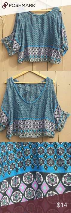 "Open sleeves, cold shoulder blue top Blue top, tie in the back of the neck, 100% rayon, really flowy and cute to pair with shorts, jeans.  Open sleeves, cold shoulder top.  Worn a few times, in great condition.  Approximately 19"" from top to bottom, 24"" across armpits. Tops"