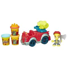Play-Doh Town Fire Truck Includes Fire Truck with removable water cannon extruder, firefighter figure with hat, flame stamper, axe, and 3 cans of Play-Doh Brand Modeling Compound.