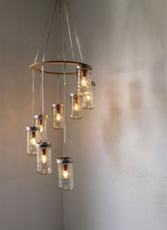 Canning Jar Waterfall Chandelier - Spiral Mason Jar Chandelier Hanging Swag Lighting Fixture - Quilted Diamond Clear Glass upcycled lamp. $200.00, via Etsy.