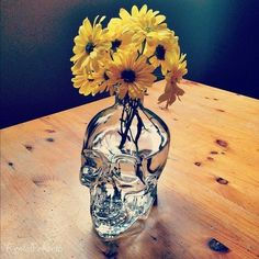 I have a little skull glass vase and love doing this!! So cute!