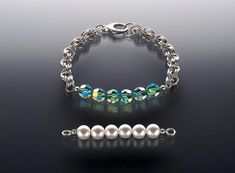 Interchangeable Maille Bracelet with Sue Ripsch Level: All Levels Technique: Bead Stringing/Knotting, Chain Maille