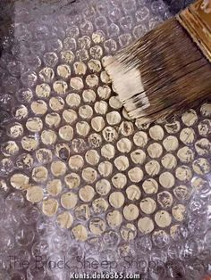 icu ~ Applying paint to bubble wrap to create a honeycomb effect. ~ Applying paint to bubble wrap to create a honeycomb effect.