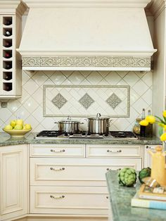 Grand Backsplash An ample hood and decorative tiles make the cooking area an… Green Granite Countertops, Outdoor Kitchen Countertops, Kitchen Tiles, New Kitchen, Kitchen Decor, Kitchen Design, Kitchen Cabinets, Stylish Kitchen, Stove Backsplash