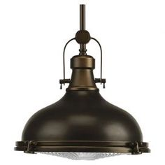 "Highlighted by an industrial-chic shade and an oil rubbed bronze finish, multiples of this handsome pendant can be lined above your kitchen island or breakfast bar for a rustically refined feel.  Product: PendantConstruction Material: Metal and glassColor: Oil rubbed bronzeFeatures: 120"" Cord length Accommodates: (1) 100 Watt incandescent bulb - not included Dimensions: 10.5"" H x 12.125"" Diameter (fixture) Note: Dimmers can be used with any incandescent or halogen light bulbs"