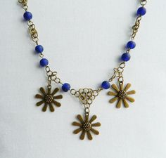 Bronze Daisy Necklace and Earrings Set by Bluebirdsanddaisies, £15.00