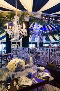 A nautical themed wedding tent transforms this indoor wedding venue to exactly what the bride and groom envision.