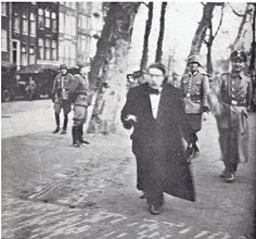 sliding into darkness  The terrible image of laughing Nazi's and a Dutch Jew in mortal fear  (Occupied Amsterdam, 1941)