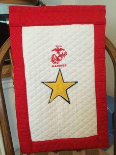 Gold star banner for deceased Marine.  https://m.facebook.com/RyanRaesCreations/