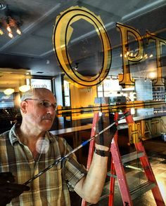 Robert Frese of Chicagold Signs working on  Optimo Hats new flagship store.