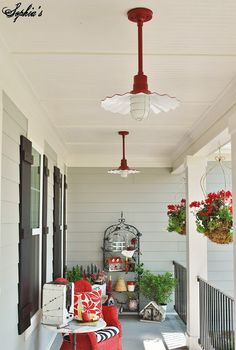 Sophias: Farmhouse Front Porch with Pops of Red #homedecor
