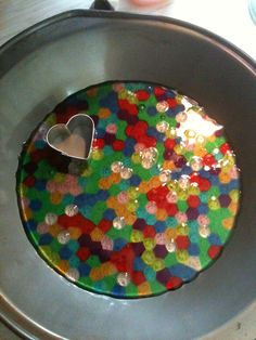 First sun-catcher! What a great use of water beads after the kids play with them!