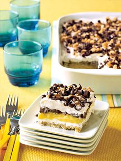 This make-ahead dessert consists of five delicious layers not counting the nut and chocolate garnish. When cut into squares, note the walnut crust, the cream cheese layer, the vanilla pudding, the ch...see more