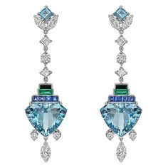 Raymond C. Yard Multicolored Gemstone Diamond Drop Earrings. Multicolored gemstone and diamond long drop earrings, showcasing two fine shield-shaped aquamarines weighing 11.57 total carats, accented by sixteen marquise, square and round-cut diamonds...as well as eight square-cut sapphires... two baguette-cut emeralds .. two square-cut aquamarines and two carved black onyx, mounted in platinum. c 2010