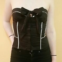 Bebe Cotton Bustier Adorable and sexy black cotton bustier with white satin trim and bow at neckline. Stretch ribbing on the back with boning for extra support on the sides. Hidden button-up front. bebe Tops