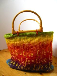 Beautiful tapestry crochet bag--pattern not available yet but the artist, Irene Lundgard (original source of photo), promises soon.  Look for more here:  www.yarnclasses.com