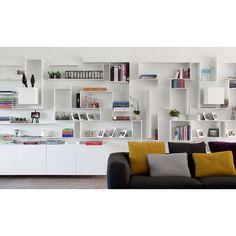 Avoid monoton shelves by make it look like a labyrinth. Pretty cool, right? #interior #interiordesign #desaininterior #shelves #display #livingroom #ivingroomdesign #ruangkeluarga #desainruangkeluarga #rakpajangan