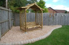 Arbour with swing seat - a perfect shady place in which to relax.