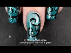 Teal holo gradient with freehand swirls and glitters nail art