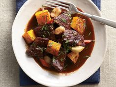Braised Winter Squash and Pork with Red Wine http://www.prevention.com/food/cook/healthy-red-meat-recipes-from-mark-bittman/braised-winter-squash-and-pork-red-wine