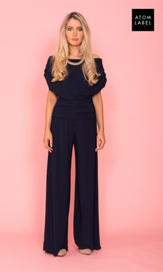 e1ca1adb0525 Atom Label by Jolaby Carbon jumpsuit in navy is a trouser suit with off-the  shoulder neckline and sleeves. The jumpsuit is ruched softly across the  tummy ...