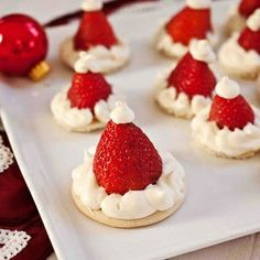 Top sugar cookies with strawberries and cream cheese frosting - snack idea for class Christmas party..