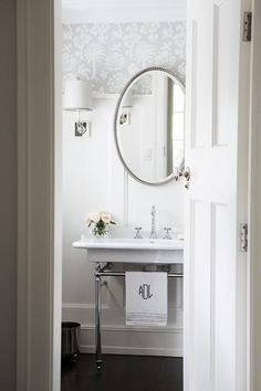 White And Silver Transitional Powder Room Boasts A Nickel And Marble 2 Leg  Washstand Placed On