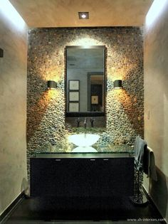 Powder room tile wall - love the pebbles and lighting!