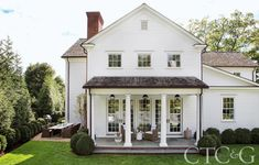 Traditional white home with southern porch and columns. Designer John Bjørnen Takes a Greenwich Colonial to the Next Level - Connecticut Cottages & Gardens - September 2017 - Connecticut Patio Design, Exterior Design, House Design, Loft Design, Exterior Paint, Modern Design, Connecticut, Modern Farmhouse, Farmhouse Style