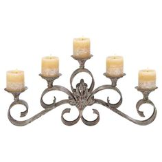 Scrolling metal candleholder with a weathered finish.   Product: CandleholderConstruction Material: Metal ...