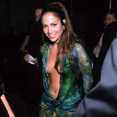 Jennifer LopezVersace are reissuing the plunging green dress made famous by Jennifer Lopez. The fashion house are re-releasing the iconic emerald gown worn by t Emerald Gown, Jennifer Lopez Dress, Green Dress, Dress Making, Bring It On, Gowns, Sneaker, Dresses, Fashion